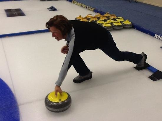 Indoor Curling Rink: left handed technique