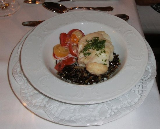 s´Badische Wirtshus im Hotel Schloss Reinach: Monkfish served on a ragout of cherry tomatoes with thyme and wild rice
