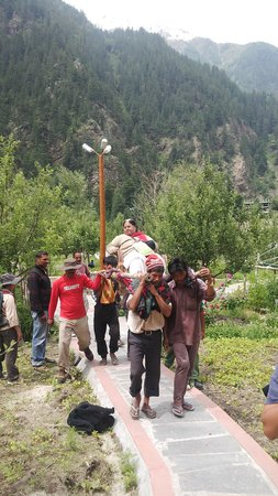 Banjara Camp &  Retreat - Sangla Valley Camp : Mom being carried out of camp by Banjara team