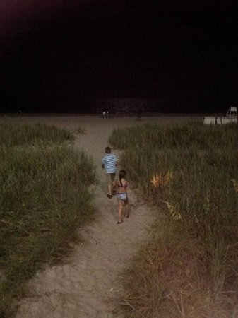 Boardwalk Beach Resort: Grandkids walking on the beach @ night