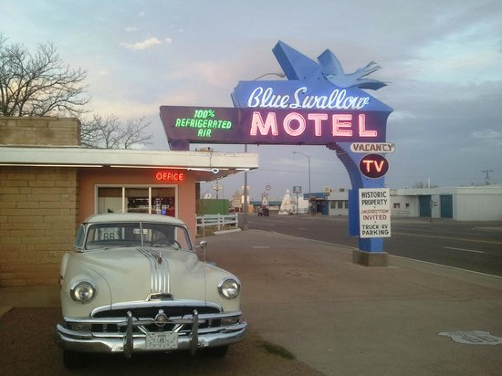 Blue Swallow Motel: Pontiac and Neons.