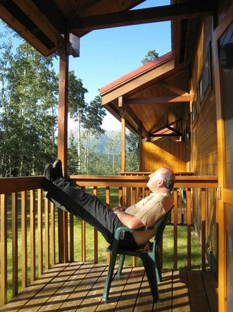 Kenai Princess Wilderness Lodge: My husband, basking in the Alaskan sun on our deck