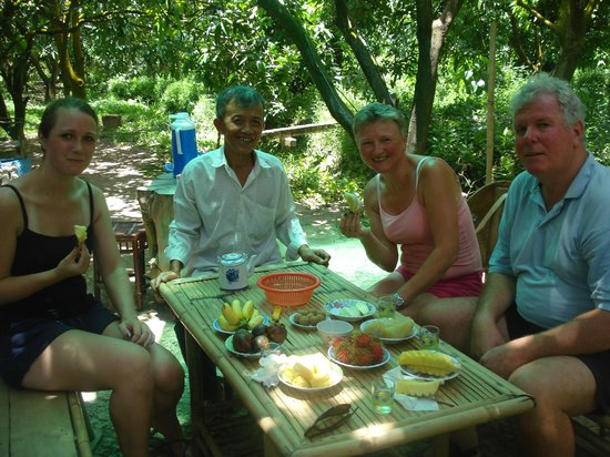Exotissimo Travel Vietnam Day Tours: Tasting exotic fruit at Mr Hai's jungle orchard
