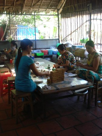 Exotissimo Travel Vietnam Day Tours: Ladies packing sweets at the sweet factory