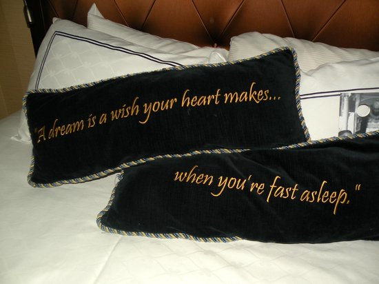 Disneyland Hotel Cute Pillows That Are On The Bed