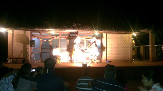 Our Native Village: the local stage of outdoor pre-dinner entertainment, lovely relaxing room behind 4 corporate eve