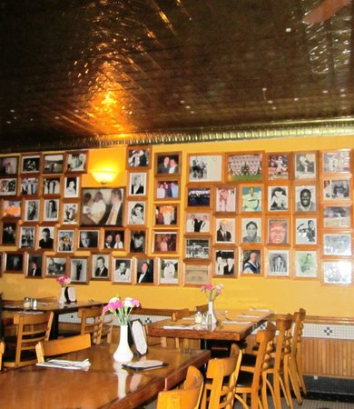 Vincent's Restaurant: Dining room wall with photos