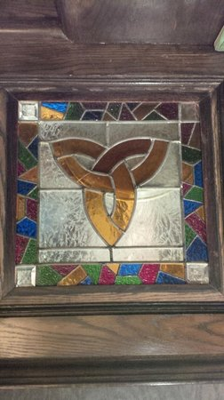 The Old Triangle Irish Ale House: Stain Glass by the bar