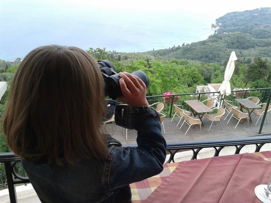Balis Taverna: Checking out the view with the taverna's binoculars!