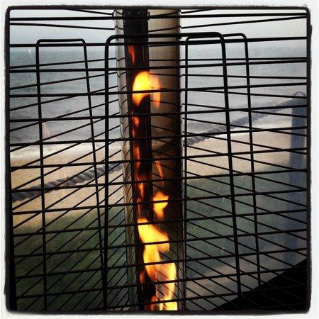 Ocean House Restaurant : A view of the ocean through the heater lamps at the Beach Bar.