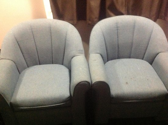 Flamingo Inn: Two stained chairs