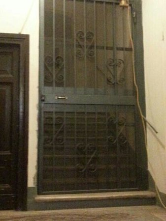 La Mongolfiera Rooms: the locked gate inside the door from the street