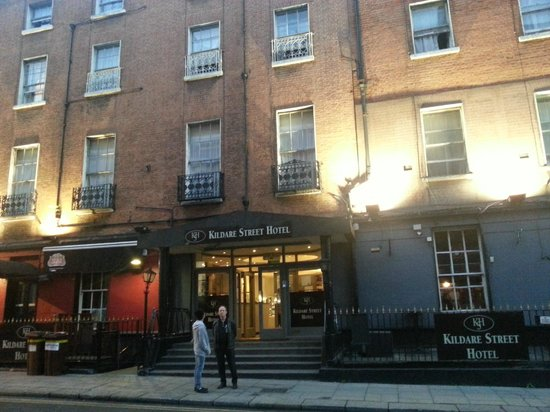 Inf-front of Kildare Street Hotel - my son & husband