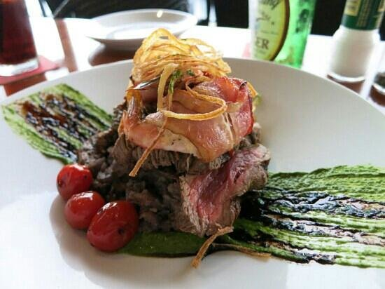 Jaco's Bayfront Bar & Grille: Steak with bacon rolled shrimps, onions, mashed potatoes and pesto saucem Yummy!!!
