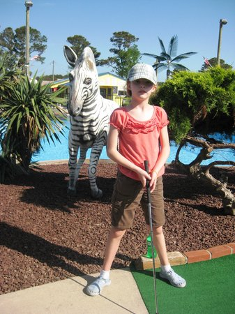 Refuge Golf & Bumper Boats: Granddaughter Playing a Hole