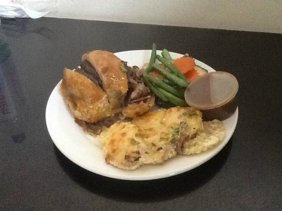 The Boston restaurant: Beef Wellington, au gratin and mixed veg with pepper sauce