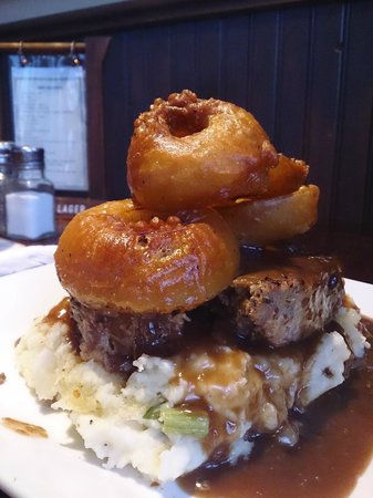 Stonewater Pub and Irish Eatery: Irish Meatloaf with mash potatos and three home battered onion rings.