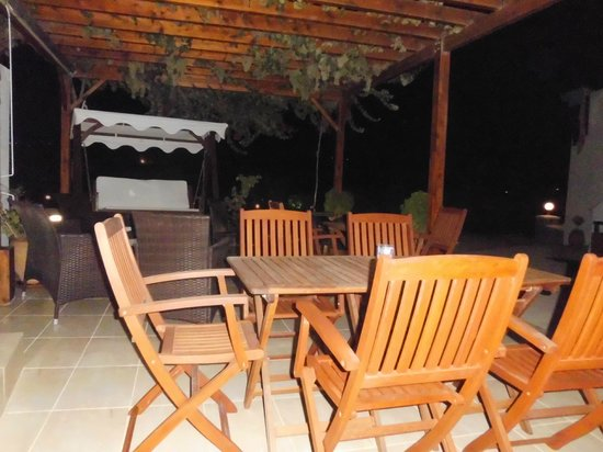 Konstantinos: Terrace where you get brekfast - the picture is taken at night