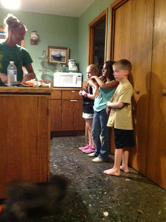 The Chetco River Inn : kids lining up for dinner, huge kitchen open to living and dining areas. pantry to right of kids