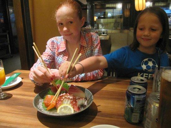 Sushi Tei - VivoCity: Attacking that sashimi - the octopus was fantastic.