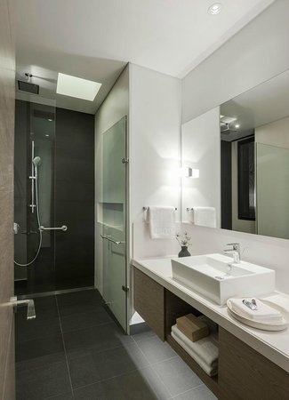 8010 Urban Living : Private bathroom with roof and hand shower