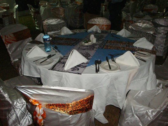 Great Rift Valley Lodge & Golf Resort: Bush dinner elegant set-up outdoors on the property