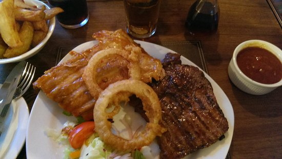 The King William IV Pub: steaks, ribs & burgers to die for. The best cooked steaks on the west coast, cooked to your liki