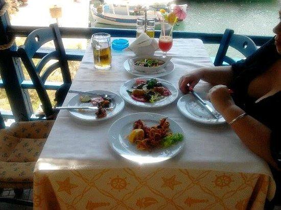 Thalassinos Kosmos: Starters...Fried Calamari, stuffed vine leaves, stuffed Zucchini flowers and baked feta......del