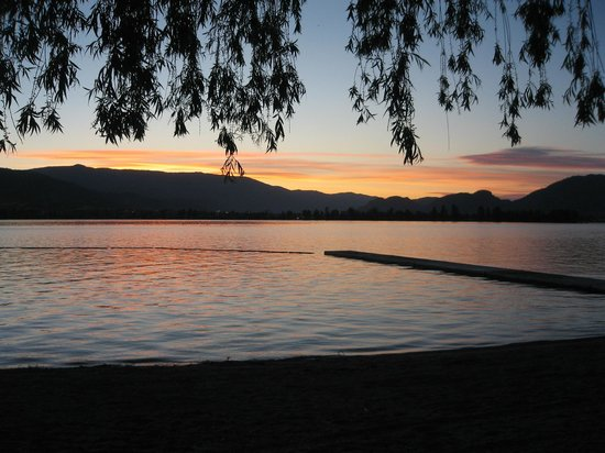 Cabana Beach Campground & RV Park : Evening view of swim area looking towards west Osoyoos.