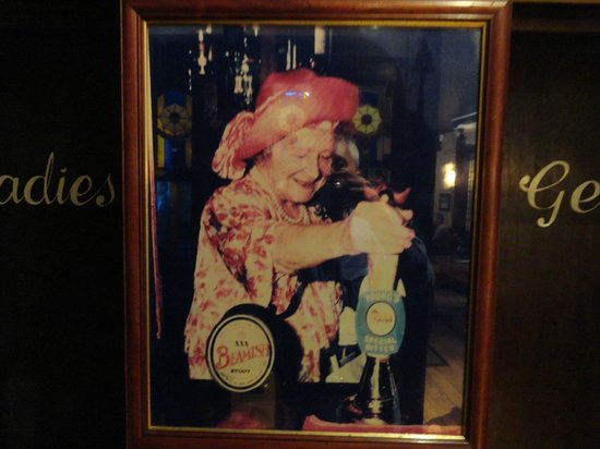 Buckingham Arms : A photo of the Queen Mother pulling a pint of Young's beer.