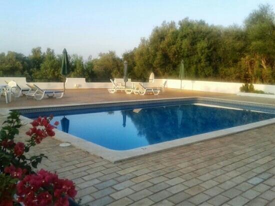 Villa Feliz Apartments: the pool at about 7.30 a.m