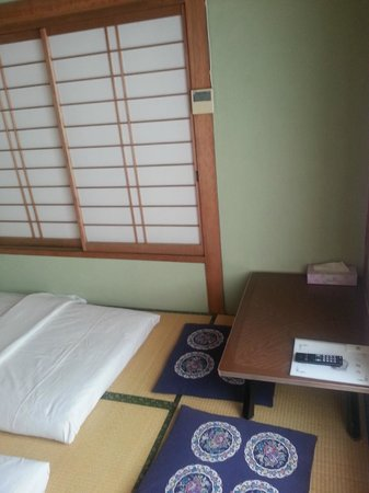 Matsukaze Ryokan: futon and a small table