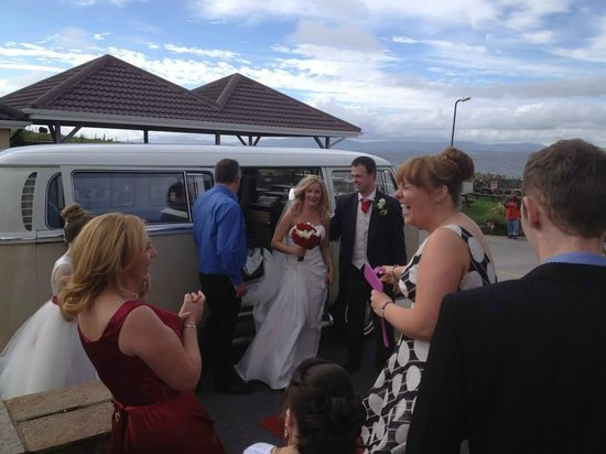 Creevy Pier Hotel : Arrival of Bride and Groom with view of coast in background