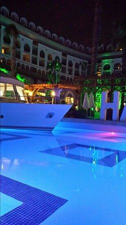 Crystal Sunset Luxury Resort & Spa: night time by the pool