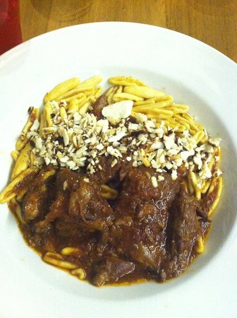 Herb's Garden: Unbelievably delicious pork dish with homemade pasta and crumbled pistachios. MUST EAT THIS.