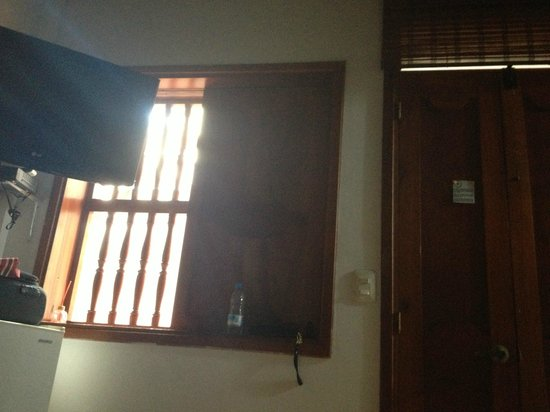 Hotel Casa del Curato : Dark room, no privacy, this window faces the walk hall for the other rooms, other hotel guests s