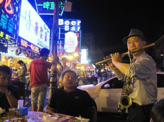Qingdao Beer Street: Flute performer