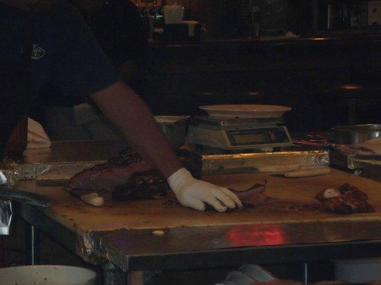 Salt Lick BBQ: meat being carved