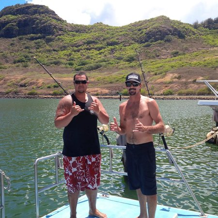 Ohana Fishing Charters: The Captain & First Mate (captain wearing the hat)