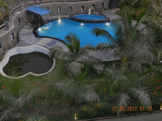 Swimming pool with waterfall picture of mystica resort khandala tripadvisor for Resorts in khandala with swimming pool