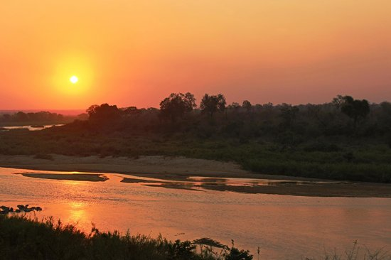 Ngwenya Lodge: Every day the sun set was brilliant from our lodge.