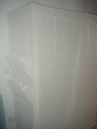 Sunart View B&B: curtain covered wire framed cupboard