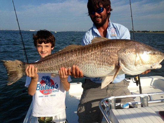 Captains Source Tours: Captain Brandon and Jerry with the first Redfish of the day!