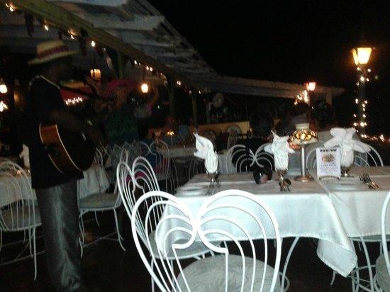 Evita's Italian Restaurant: A reggae musician entertains us at Evita's