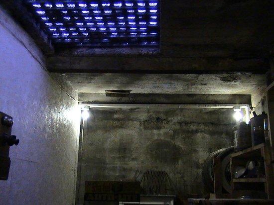 Beneath the Streets: Light source thru glass cubes in sidewalk above