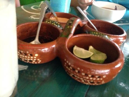 Figueroa's Burritos: salsero clay caddy used to serve homemade salsas. this adds a great touch for authentic restaura