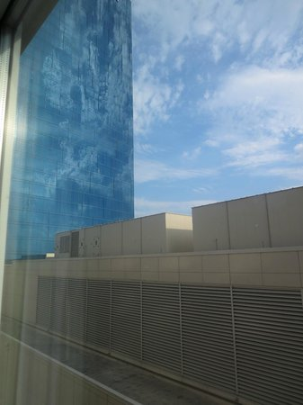 Fairfield Inn & Suites Indianapolis Downtown: neighboring JW Marriott, giant HVAC building outside the window. sideways view out the bedroom w