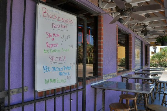 Blackbeard's On The Beach: Outside seating and menu on the front porch.