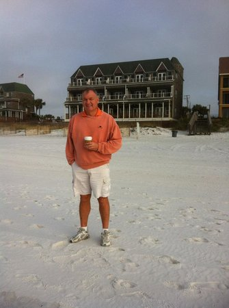 my husband with Henderson Park Inn in the background