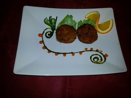 khan Tandoori : our special crabs cake with mint and mango chutney